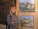 Olga Kireeva in front of some of her paintings